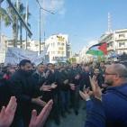 رام الله: مواطنون يحتفلون بقرار الرئيس وقف نفاذ قانون الضمان