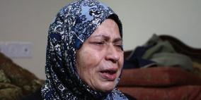 الرئيس يمنح سيدة من نابلس لقب الأم المثالية