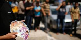 نائب فتحاوي يطالب بمحاسبة وزير المالية بسبب رواتب غزة