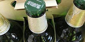 علم السعودية على أغطية منتجات كحولية