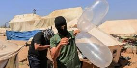 طائرة استطلاع تستهدف مجموعة من مطلقي البالونات الحارقة