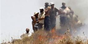 مستوطنون يحرقون منزلا وحقولا للقمح