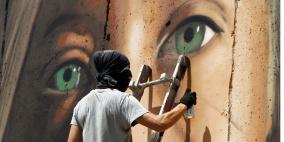 الاحتلال يطرد ايطاليين رسموا جدارية لعهد التميمي في بيت لحم