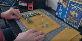 """فيديو.. صنع كمبيوتر من """"المعكرونة"""" تحديا لزوجته"""