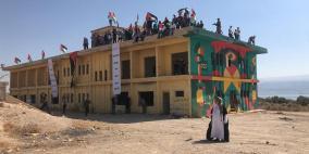رفضا للضم.. نشطاء يرفعون العلم الفلسطيني على شاطئ البحر الميت