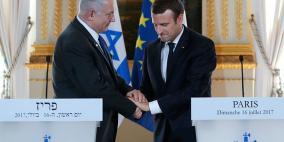 الرئيس الفرنسي يبلغ نتنياهو رفضه لقرار ترامب