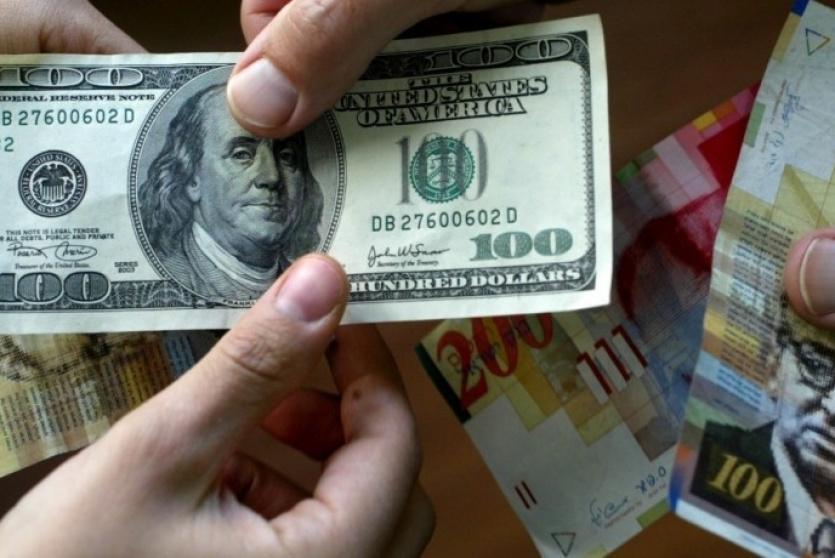 العملات - صرف الدولار مقابل الشيكل